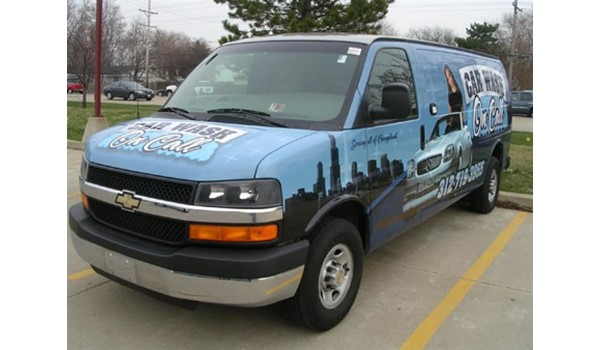 Digitally printed vinyl vehicle wrap applied to front back, sides and windows