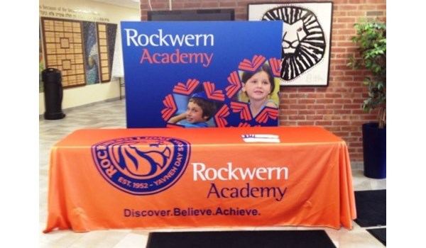 Whether you need an in house display or a display that can hit the road, we have your solution.  (Table throw and display banner by Signs Now Cincinnati for Rockwern Academy, Cincinnati, OH)