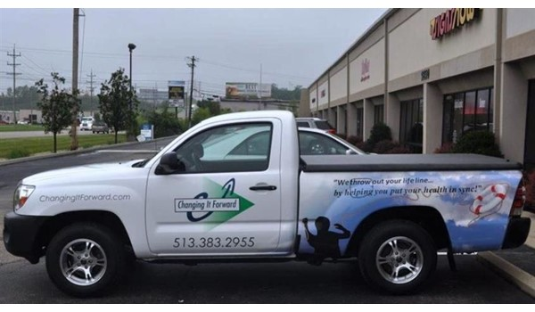 Move your business forward... with custom vehicle graphics!  (Digitally Printed Vehicle Graphics by Signs Now Cincinnati for Changing it Forward Inc., Cincinnati, OH)