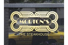 Lettering applied to windows of local, upscale steakhouse