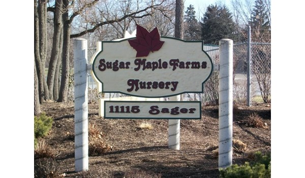 Sandblasted and painted sign, made out of high density foam, installed at a nursery near Toledo Express Airport.
