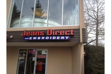 - Electric Sign - Channel Letters - Jeans Direct Embroidery - Bellevue, WA