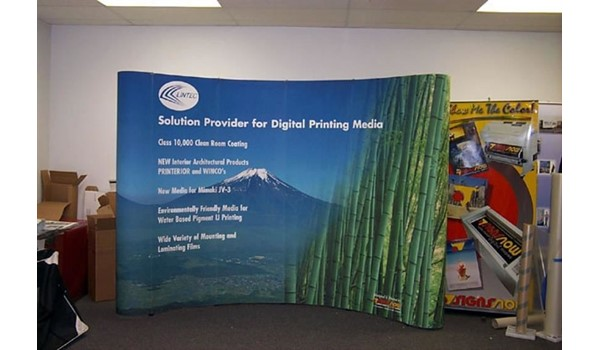 A combination including a magnetic popup display system and a retractable image banner stand