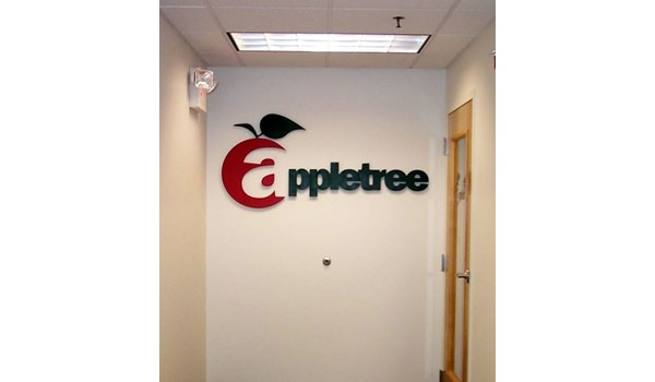 Three dimensional wall logo mounted to interior wall
