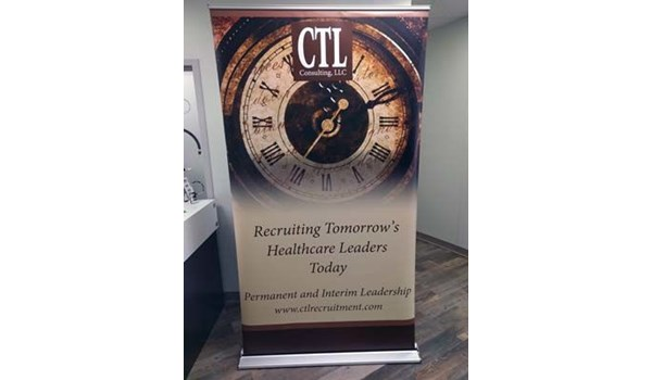 4 Ft Retractable Banner Stand with Vinyl Graphic for Turn the Page Online Marketing in Lees Summit, Missouri