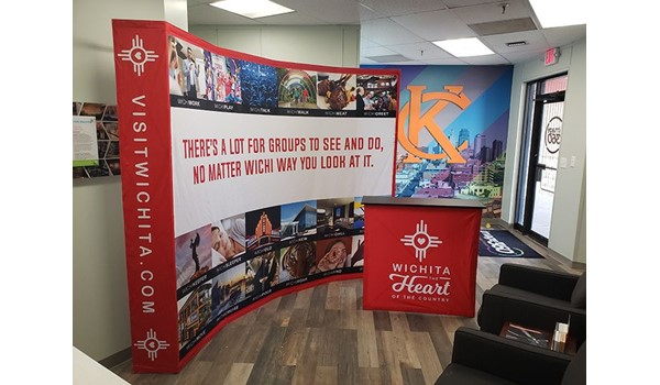Tradeshow Curved Fabric Backdrop and Counter for JNA Advertising in Kansas City, Missouri