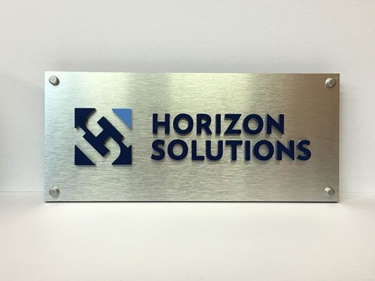 Company logo brushed aluminum dimensional letters Rochester NY