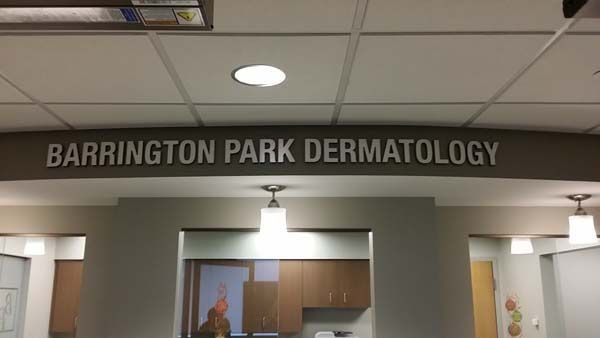 Dimensional Company Name Sign for dermatology center in Rochester, NY.