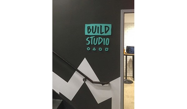 Interior dimensional logo for Build Studio in New York, NY.