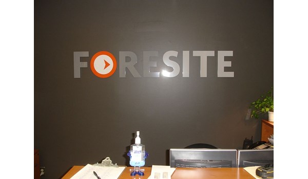 Dimensional metal lettering and logo sign  for behind reception desk for FORESITE in East Hartford, CT.