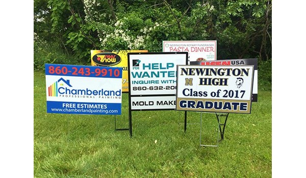 Lawn signs for various companies in Newington, CT.