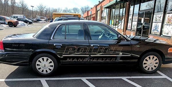 Reflective vinyl lettering for Manchester Police vehicles.