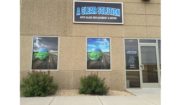 Storefront sign and window graphics using perforated vinyl