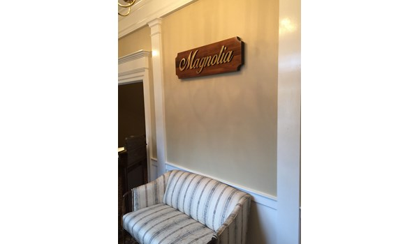 Dimensional polished brass lettering on magnolia for a funeral home in Marietta