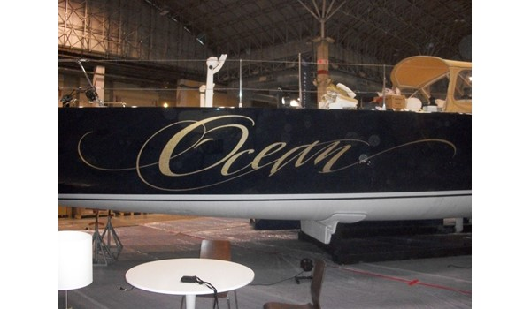 Name graphic in gold ettering on sides of yacht Waukegan, IL