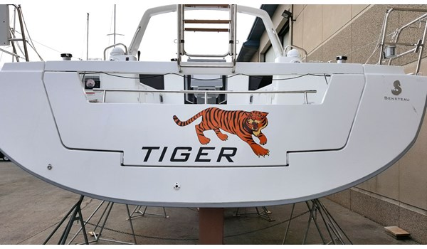 Boat name lettering and graphic installed on transom of sailboat.  Sailplace Kenosha WI