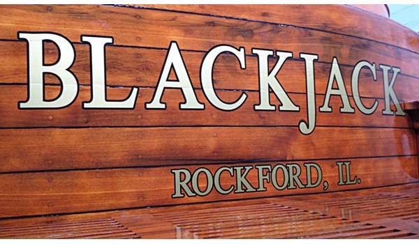 Classic wood boat with gold and black lettering by Signs Now Gurnee