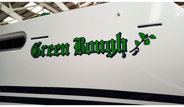 Boat name lettering and graphics in three colors applied to sailboat in Waukegan, IL