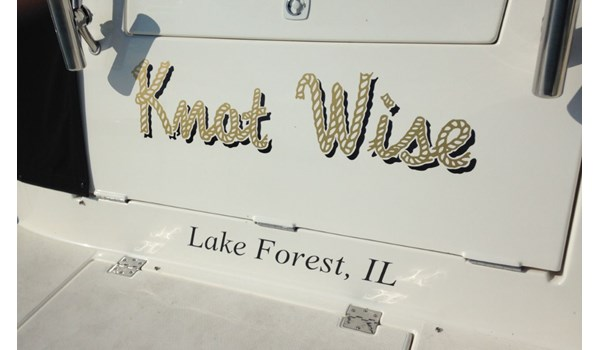 Boat name graphic in metallic gold with drop shadow