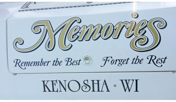 Boat lettering in metallic gold and black at Southport Marina, Kenosha WI.