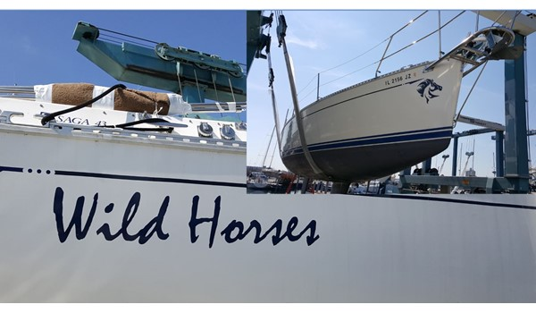 Name and horse graphic applied to sides near stern and at bow of sailboat