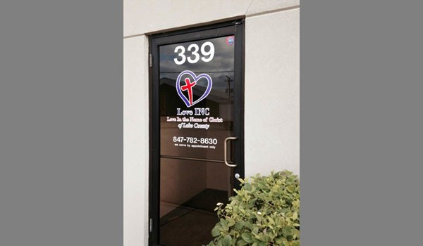 Door graphic with logo and lettering for Love INC. a non-profit supported by churches in Lake County IL.