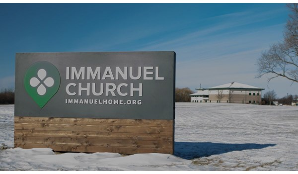 LED illuminated monument sign with push through acrylic lettering and cedar skirt for Immanuel Church in Gurnee, IL