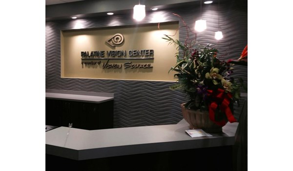 Metal faced dimensional foam logo and raised lettering in gold and silver on main lobby wall in Palatine, IL