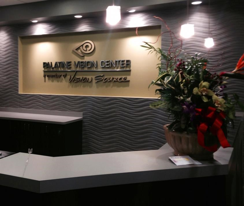 Metal faced dimensional foam logo and raised lettering in gold and silver on wall in Palatine, IL