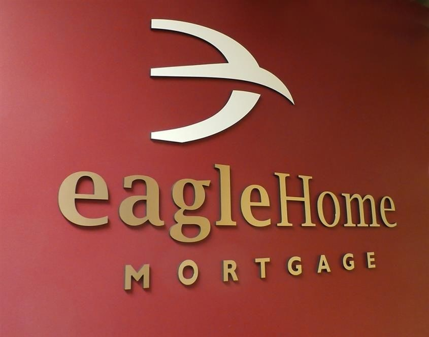 Dimensional raised letters and logo on reception area wall with painted faces in Gurnee, IL