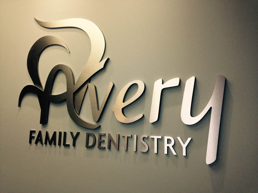 Custom 3D wall logo with brushed metal face and raised letters for dentist office in Waukegan, IL