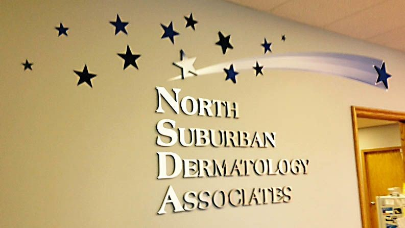Mix of dimensional letters and stars with vinyl graphics for a healthcare facility.