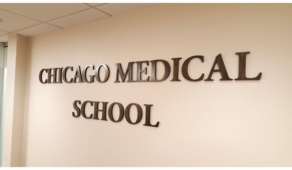 Cast bronze letters on wall for the Chicago Medical School at Rosalind Franklin University