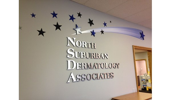 Metallic and painted dimensional lettering with vinyl graphics on doctors office reception wall in Gurnee IL