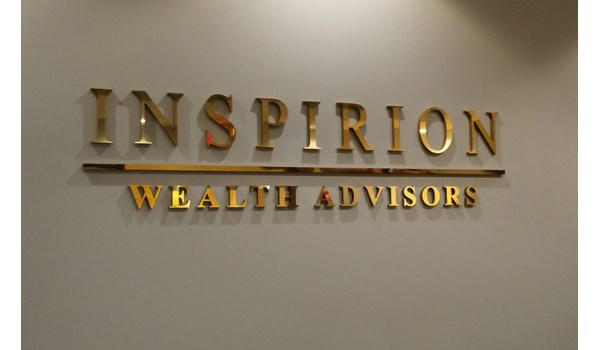 Gold dimensional letters behind reception desk in lobby Libertyville IL