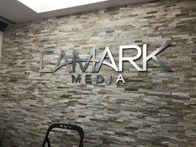 Brushed metal signage for Lamark Media