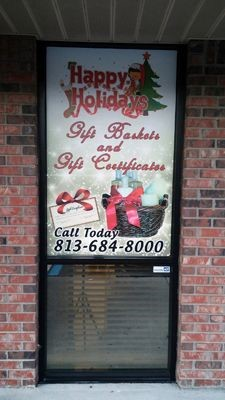 Window Graphics for A Caring Touch Window for Christmas by Image360 Tampa Ybor City FL